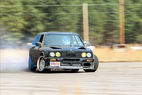 Drift racing drivers intentionally over-steer through corners to lose traction in the rear wheels, then correct to maintain control.