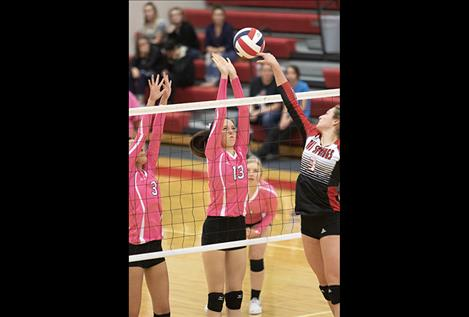 The Arlee Scarlets battle at the net.