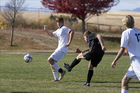 Pirate Mack Moderie fires a shot for a goal past a defender.
