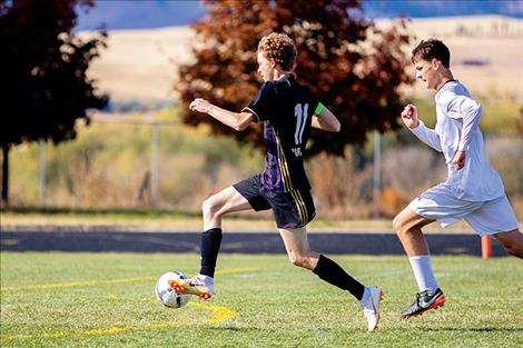 Polson Pirate Robin Erickson races past a defender during a home playoff win on Oct. 13.