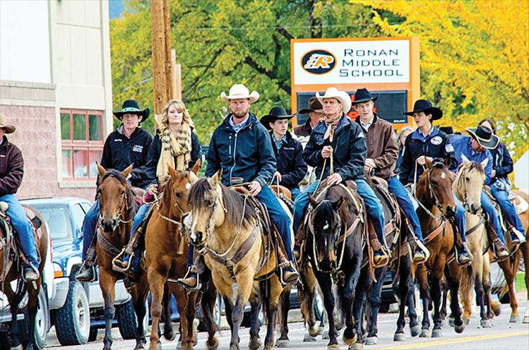 """Last ride: A procession of about 60 horses and riders moved through town towards the Ronan Community Center on Friday, Oct. 12, to honor Hugh Houle who recently passed away. The ride ended at a Celebration of Life ceremony at the center. Hugh's son, Tyler Houle, led the group and his father's horse. """"This last ride was something dad would have really loved,"""" he said."""