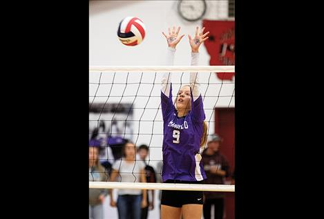 Lady Viking Carlee Fryberger keeps her eyes on the ball.