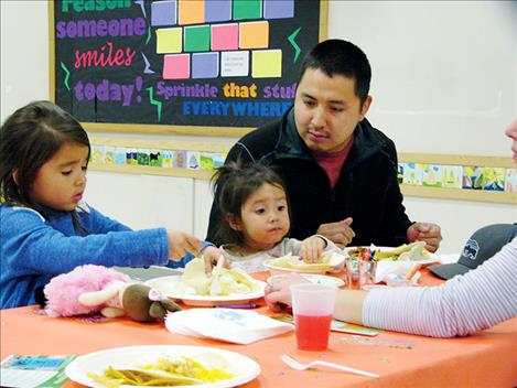 A family eats a meal together at the Arlee High School last week during a Family Dinner Project-themed event.