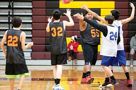 Unified hoopsters battle for the ball.