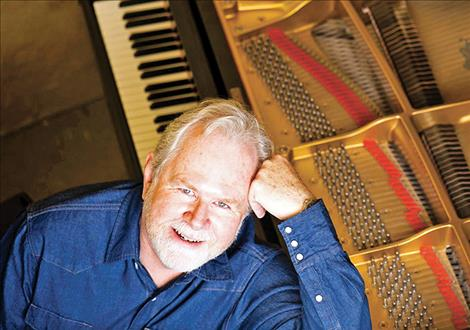 Montana pianist Phil Aaberg sits for a photo at his piano.