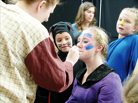 "Amelia Lamont prepares to go on stage as the ""Queen"" in Missoula Children's Theatre production of ""Snow White"" seen on the stage in Arlee Saturday."