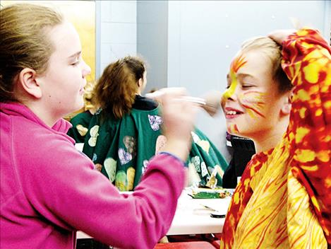 Cayden Clark helps prepare Natalee Coulson to play Snow White.