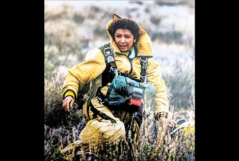 Margarita Phillips finishes one of her many jumps from an airplane during her career as a smokejumper.