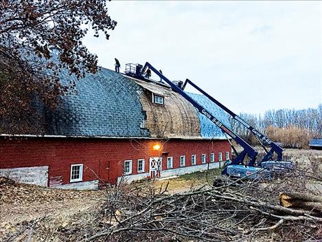 The Red Barn in St. Ignatius gets a new roof.