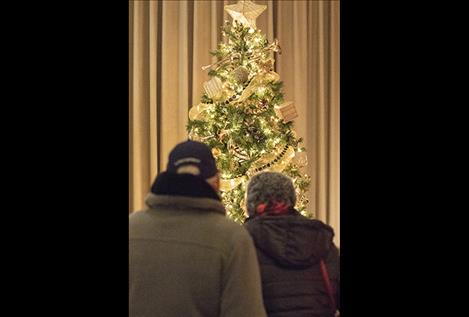 People admire decorations at the Mission Valley Festival of Trees.