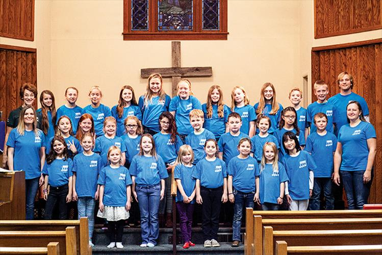The Mission Valley Children's Choir, directed by Cathy Gillhouse, practice at the Faith Lutheran Church in Ronan. They will perform from 6:30 p.m. to 7 p.m. on Friday, Dec 21 for the Lights Under the Big Sky event after the Ronan Parade of Lights.  The choir is composed of children from across the valley.