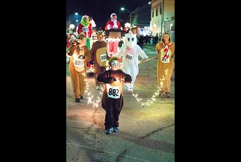 Creative participants make Friday's Parade of Lights a spectacular holiday event in downtown Polson.