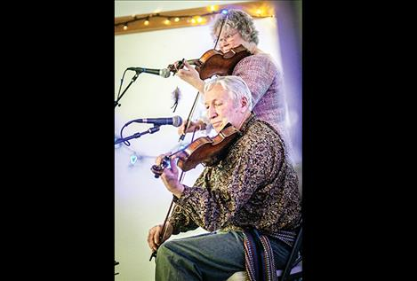 Fiddlers Del and Cheryl DesJarlais create holiday music.