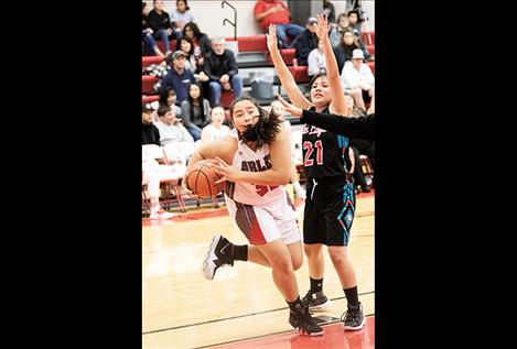 Scarlet Halle Adams battles for a rebound.