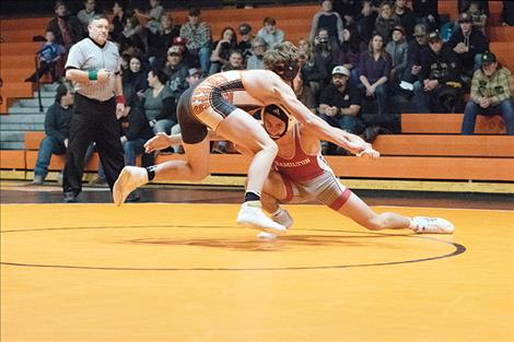 Ronan Chief wrestler Zane Walchuk quickly slips past the grasp of his opponent.