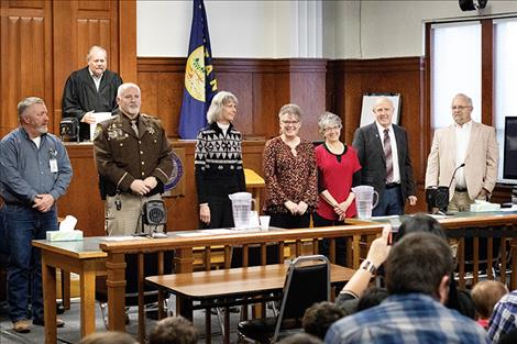 Judge James Manley stands behind newly sworn in officials,  including: Justice of the Peace Randal Owens, Lake County Sheriff Don Bell, Clerk and Recorder Paula Holle, Treasurer/Assessor Robin G. Vert-Rubel, County Superintendent of Schools Carolyn Hall, County Commissioner Gale Decker and County Attorney Steven Eschenbacher.