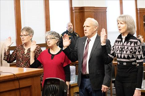 County Treasurer/Assessor Robin G. Vert-Rubel, County Superintendent of Schools Carolyn Hall, Lake County Commissioner Gale Decker and County Clerk and Recorder Paula Holle raised their right hands to take the oath of office on Dec. 19.