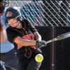 Ronan freshman Jordyn Clairmont smacks a grounder during the Maidens game against the Powell County Lady Wardens last week. Ronan won the game 6-5. 