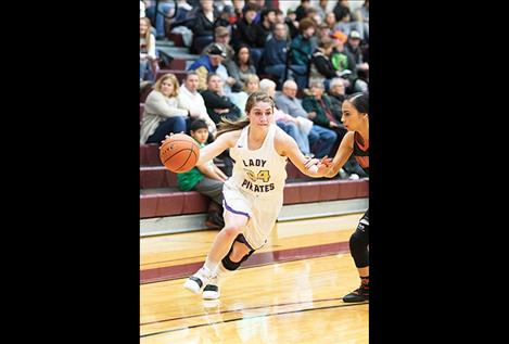 Lady Pirate Karly Lawson head toward the hoop.