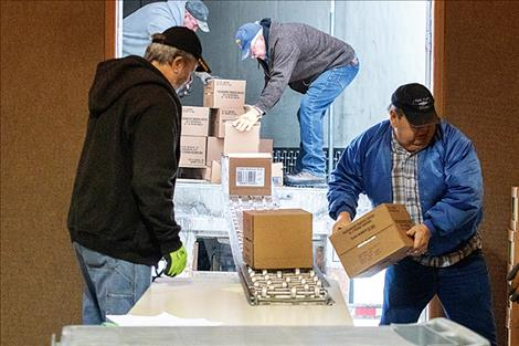 Volunteers unload 15,000 pounds of food by hand.