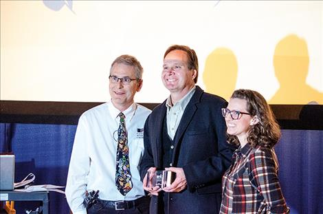 FLIC Director David W. King and Producer Jessica King present filmmaker Tim Ryan Rouillier with the Audience Award.