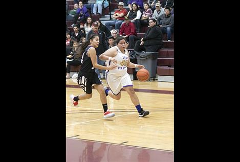 Lady Pirate  Nastasha Gravelle  races toward the hoop with the ball.