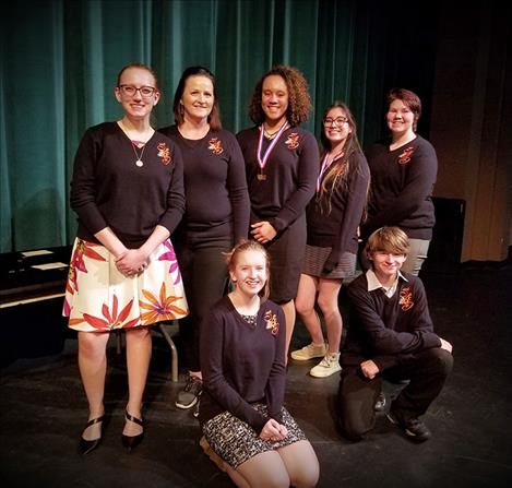 Ronan Speech and Debate team state tournament attendees include: back row,  Aurrora Watkins, senior; Coach Michelle Mallon; Kara Holmlund, senior; Sariel Sandoval,  sophomore; and Taylor Jackson, sophomore. Krya Waldoch and d'Artagnan  Dominguez are seated in front.