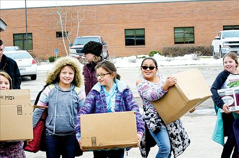 K. WIlliam Harvey students deliver 326 pounds of food to the Ronan Food Pantry Friday afternoon.