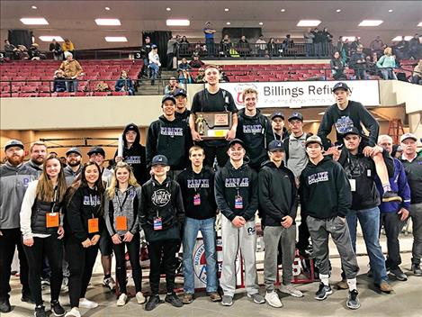 The Polson Pirate wrestling team poses for a photo with their third place state wresting trophy.