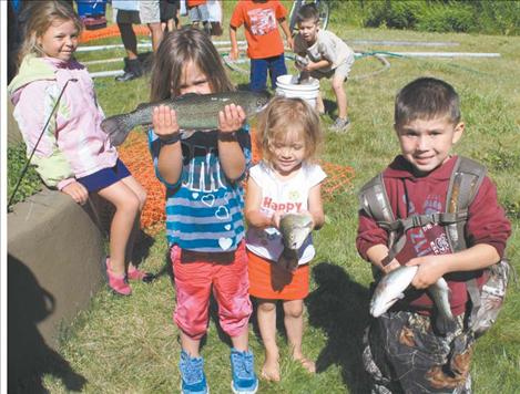 Brynn Courville, Amanda Webster, and August Courville show off their respective catches.