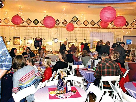 People fill the Leon Clubhouse on Saturday during the Ninepipe Arts Group fundraising event