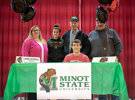 Arlee Warrior Lane Schall signs his letter of intent to play football with Minot State University, in Minot, North Dakota.