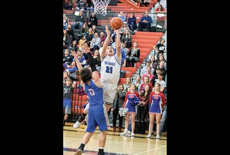 Mission Bulldog Wacey McClure slips past a defender for two points.