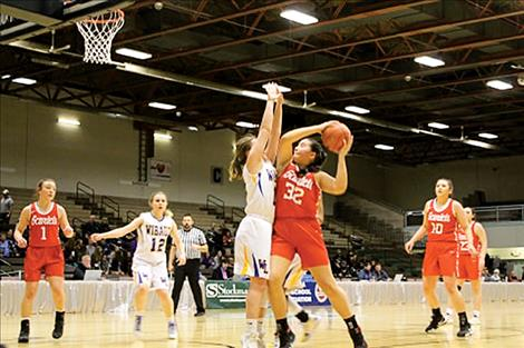 Arlee Scarlets compete during the Class C Girls State Basketball Tournament in Great Falls.