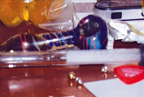 Polson Police  Department officers find drug paraphernalia after serving a search warrant in Polson.