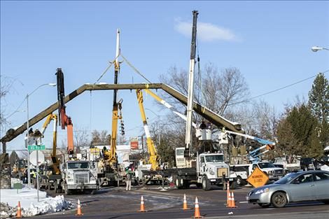 A crew takes down the Ronan arch on Main Street.