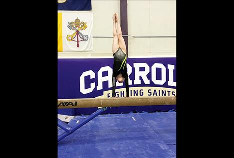 Lauren Collinge competes on the beam. She finished third in both the balance beam and the vault.