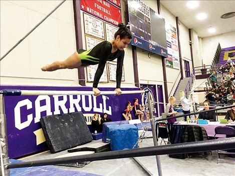 Chenoa Villegas competes on the bars.