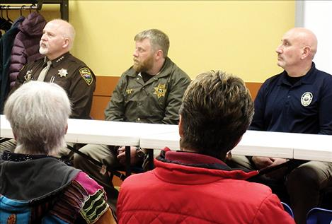 A panel of law enforcement officers, including Lake County Sheriff Don Bell, Lieutenant Levi Read, CSKT Tribal Police Chief Craige Couture and Polson Police Sgt. George Simpson, below, addressed local drug issues during the event.