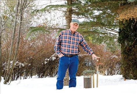 Tom Vaughn stands next to the water well on his property where high levels of arsenic were found.