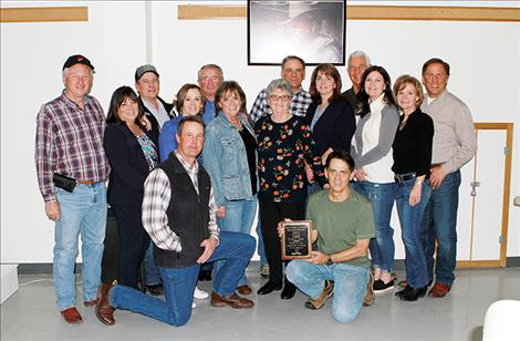 At the 41st Agriculture Appreciation Dinner held last month, the family of Everett Foust accepts a posthumous award for his lifelong dedication to agriculture, family and community.