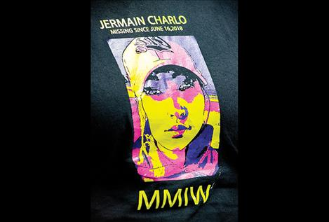 Jermain Charlo's image is printed on the T-shirts worn by many walkers.