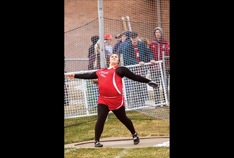 Arlee Scarlett Peyton  Lammerding wins first place  in the shot put event.