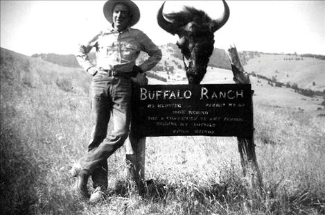 Ike Melton stands beside his ranch sign.