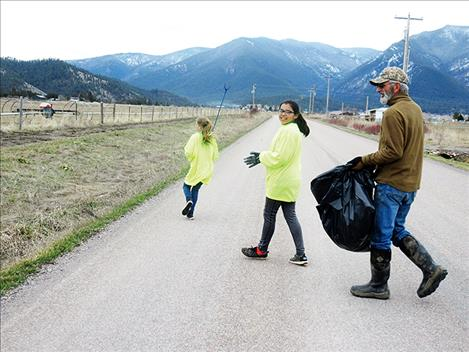 Toni Hadley, Dvaiah Gasco and another volunteer clean up trash on Jocko Road.