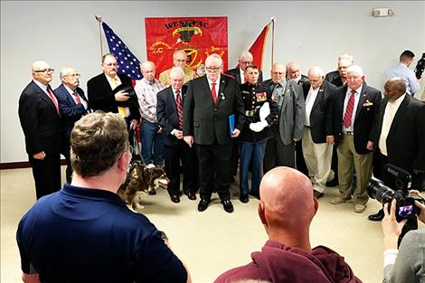 Veteran Marines at the ceremony stand together at the VFW.