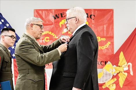 Lieutenant General Frank Libutti pins the Navy Cross on Lance Cpl. James Stogner.