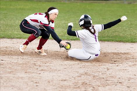 Lady Pirate Lisa Costilla beats the throw to second.