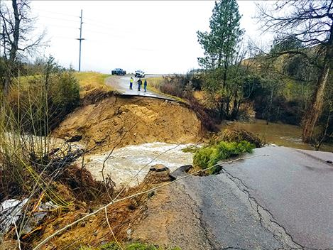 Mark Clary photo Dublin Gulch Road erodes from flood waters April 10. It could take months before it is repaired and re-opened.