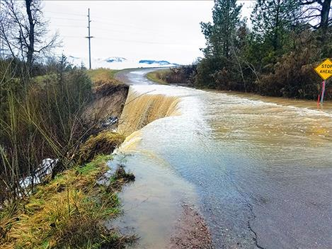 Water spills over Dublin Gulch Road on April 10 before the road washes away.